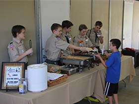 Boy Scouts serve lunch to Camelot student Diego at Hooves & Heroes 2016