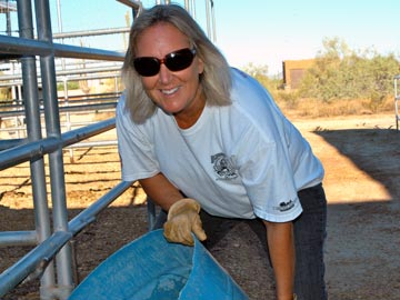smiling volunteer emptying water tub