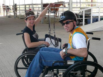 volunteer and student in wheelchairs with bridle