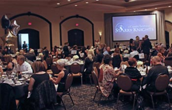 Guests seated and eating dinner at Starry Knights 2017